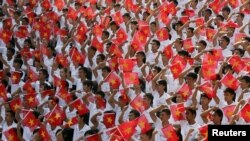 Students wave the Vietnamese national flag