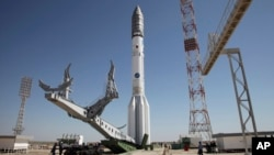 FILE - A Proton-M rocket is installed at Baikonur launch pad in Kazakhstan, May 13, 2014.