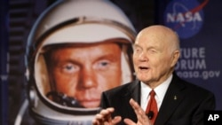 FILE - U.S. Sen. John Glenn talks with astronauts on the International Space Station via satellite in Columbus, Ohio, Feb. 20, 2012.