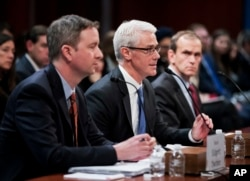 Twitter's acting General Counsel Sean Edgett, from left, Facebook's General Counsel Colin Stretch and Google's Senior Vice President and General Counsel Kent Walker, testify before a House Intelligence Committee hearing on Capitol Hill in Washington, Nov. 1, 2017.