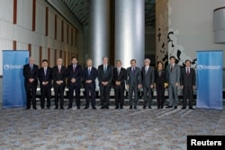 "FILE - Trade ministers from a dozen Pacific nations in Trans-Pacific Partnership Ministers post-meeting in TPP Ministers ""Family Photo"" in Atlanta, Georgia, Oct. 1, 2015."