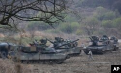FILE - U.S. Army tanks conduct a military exercise in Paju, South Korea, near the border with North Korea, April 14, 2017.