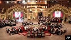 FILE - Gulf leaders meet during a Gulf Cooperation Council summit in Doha, Qatar, December 2014.