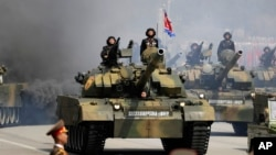 FILE - Soldiers in tanks are paraded across Kim Il Sung Square during a military parade, April 15, 2017, in Pyongyang, North Korea. The United Nations is investigating at least seven African countries accused of receiving military assistance from North Korea.