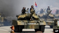 FILE - Soldiers in tanks are paraded across Kim Il Sung Square during a military parade, April 15, 2017, in Pyongyang, North Korea. The United Nations is investigating at least seven African countries accused of receiving military assistance from North Ko