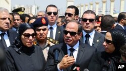 FILE - Egyptian President Abdel-Fattah el-Sissi, center, speaks at the funeral for Hisham Barakat, surrounded by the latter's family members, June 30, 2015.
