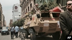 FILE - Soldiers guard a street near a church in downtown Cairo, Egypt, April 10, 2017, following Palm Sunday bombings in churches in Tanta and Alexandria that killed 45 Coptic Christians.