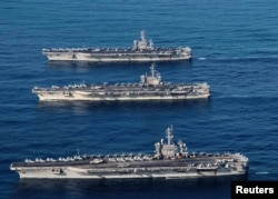 FILE PHOTO - The aircraft carriers USS Ronald Reagan (CVN 76), USS Theodore Roosevelt (CVN 71) and USS Nimitz (CVN 68) are underway, conducting operations, in international waters as part of a three-carrier strike force exercise in western Pacific, Novemb