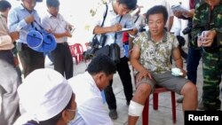 After his boat allegedly was rammed and sunk by Chinese vessels, an unidentified Vietnamese fisherman receives medical treatment on Vietnam's Ly Son island, May 29, 2014.