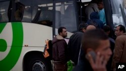 FILE - Palestinians laborers board a Palestinian-only bus on route to the West Bank after working in the Tel Aviv, March 4, 2013.