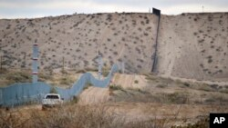 FILE - A U.S. Border Patrol vehicle drives near the U.S.-Mexico border fence in Sunland Park, New Mexico. The contruction of a border wall was among Donald Trump's major talking points during the campaign.