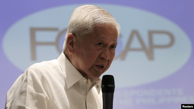 FILE - Albert del Rosario, at the time foreign secretary of the Philippines, is seen speaking to reporters in Manila, March 26, 2015.