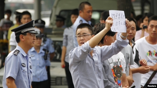 Demonstrators protest outside the Japanese embassy in Beijing on Sept. 11, 2012.