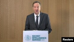 FILE - Britain's MI6 chief Alex Younger speaks at MI6's Vauxhall Cross headquarters in central London, Britain, in this still image from video, Dec. 8, 2016.