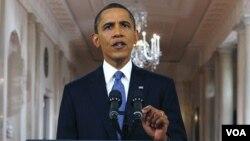 Presiden AS Barack Obama menyampaikan pidato lewat televisi di Gedung Putih, mengenai rencana penarikan pasukan AS dari Afghanistan, Rabu malam (22/6).