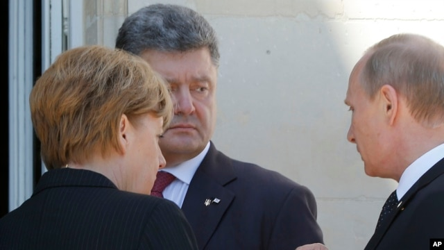 German Chancellor Angela Merkel, left, Russian President Vladimir Putin, right, and Ukrainian president-elect Petro Poroshenko, center, talk after a group photo, June 6, 2014.