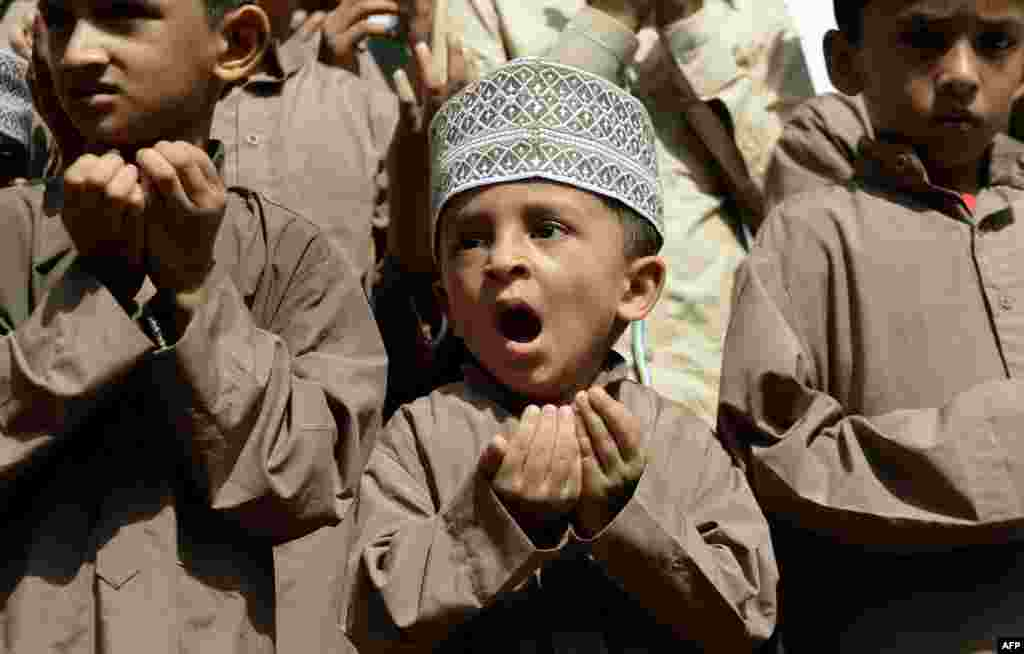 A Muslim boy reacts as he takes part in a special prayer for better rainfall, in Mumbai, India.