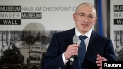 Freed Russian former oil tycoon Mikhail Khodorkovsky speaks during his news conference in the Museum Haus am Checkpoint Charlie in Berlin, December 22, 2013.