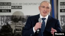 FILE - Russian former oil tycoon Mikhail Khodorkovsky speaks during a news conference in the Museum Haus am Checkpoint Charlie in Berlin, December 2013.