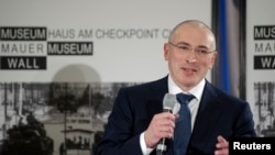 FILE – After Yukos shareholder Mikhail Khodorkovsky, shown in 2013, ran afoul of Russian President Vladimir Putin, the company was forced into bankruptcy. Losses blamed on Russia's government have new sparked legal battles.