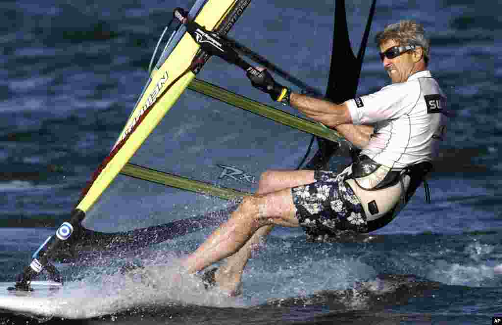 John Kerry windsurfs off the coast of Nantucket, Massachusetts when he was the Democratic presidential candidate, August 30, 2004.