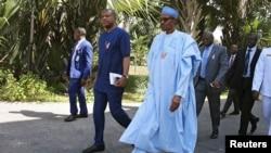 Le président Muhammadu Buhari lors de son arrivée à Banjul, en Gambie, le 13 décembre 2016.