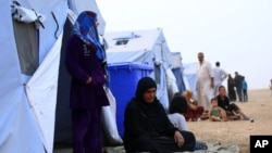 Fleeing insurgents, refugees from the Iraqi city of Mosul find shelter at Khazir camp near Irbil on June 12, 2014.