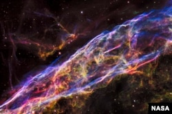FILE - NASA's Hubble Space Telescope unveiled in stunning detail a small section of the expanding remains of a massive star that exploded about 8,000 years ago.