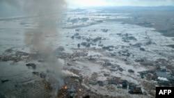 Cảnh tàn phá trong quận Miyagi thuộc thành phố Natori của Nhật sau động đất và sóng thần