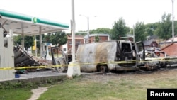 A burned down gas station is seen after disturbances following the police shooting of a man in Milwaukee, Wisconsin, U.S. Aug. 15, 2016.