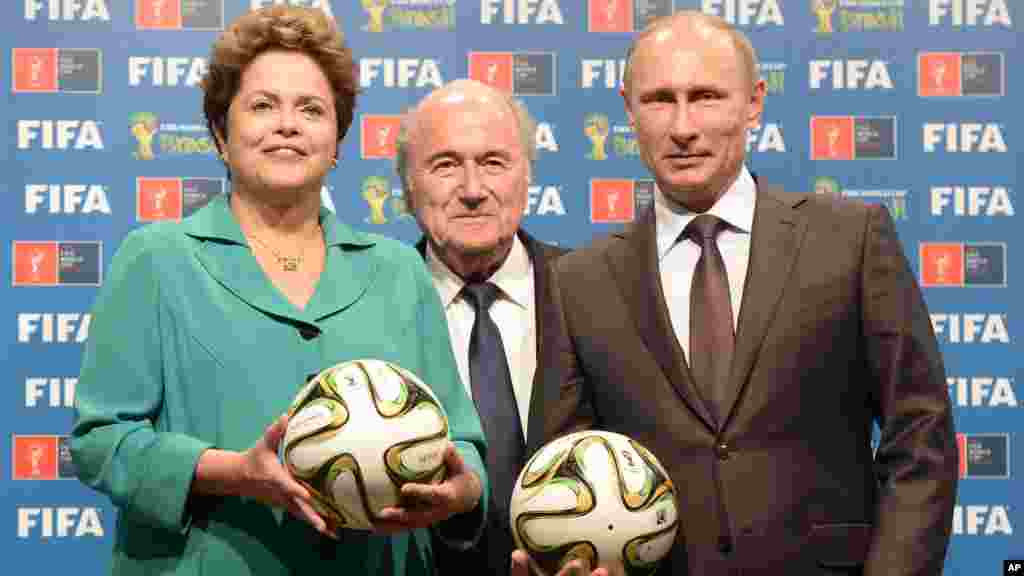Brazil's President Dilma Rousseff, FIFA President Sepp Blatter, and Russian President Vladimir Putin during the official ceremony of handover to Russia as the 2018 World Cup, July 13, 2014.