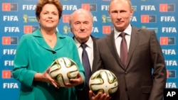 FILE – From left, Brazilian President Dilma Rousseff and FIFA chief Sepp Blatter hand over World Cup hosting duties to Russian leader Vladimir Putin after the 2014 final match in Rio de Janeiro, July 13, 2014.