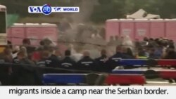 VOA60 World - Hungarian police use tear gas to disperse migrants - August 26, 2015