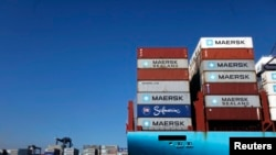 FILE - Containers are stacked on a ship in the port of Lazaro Cardenas, Mexico, Nov. 21, 2013.