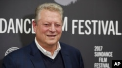 """Former Vice President Al Gore poses at the premiere of the film """"An Inconvenient Sequel: Truth to Power"""" at the Eccles Theater during the 2017 Sundance Film Festival, Jan. 19, 2017, in Park City, Utah."""