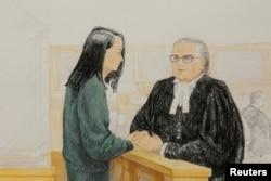 孟晚舟和她的律师2018年12月10日在法庭上