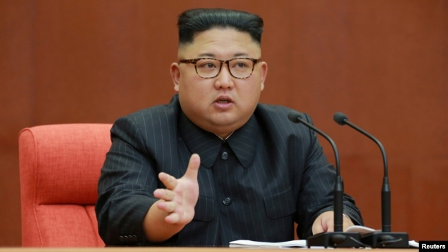 FILE - Kim Jong Un speaks during the Second Plenum of the 7th Central Committee of the Workers' Party of Korea at the Kumsusan Palace of the Sun, in this undated photo released by North Korea's Korean Central News Agency (KCNA) in Pyongyang, Oct. 8, 2017.