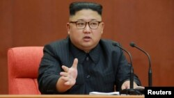 Kim Jong Un speaks during the Second Plenum of the 7th Central Committee of the Workers' Party of Korea (WPK) at the Kumsusan Palace of the Sun, in this undated photo released by North Korea's Korean Central News Agency (KCNA) in Pyongyang, Oct. 8, 2017.