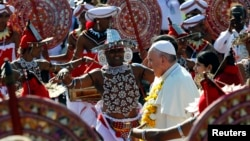 Pope Francis is greeted upon his arrival at the Colombo's Bandaranaike international airport, Jan. 13, 2015.