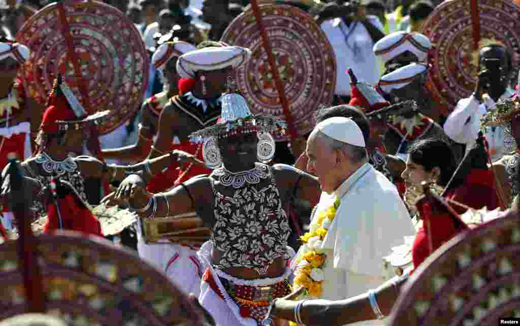 Pope Francis is greeted as he arrives at the Colombo Airport, Sri Lanka, Jan. 13, 2015.