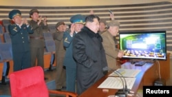 North Korean leader Kim Jong Un reacts as he watches a long range rocket launch in this undated photo released by North Korea's Korean Central News Agency (KCNA) in Pyongyang, Feb. 7, 2016.