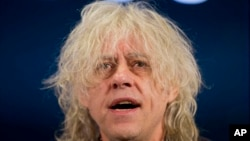 Irish singer-songwriter and campaigner Bob Geldof speaks during a press briefing in London with Scottish musician and singer-songwriter Midge Ure, to announce the launch of #BandAid30 to raise funds to fight Ebola in west Africa, Monday, Nov. 10, 2014.