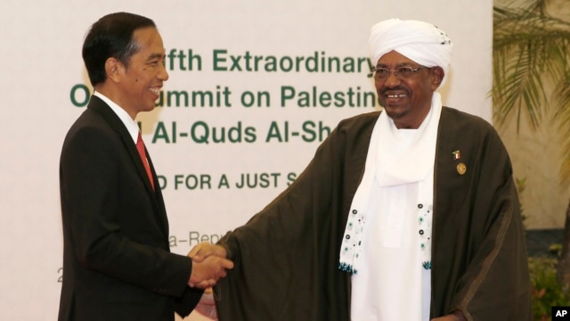 "Indonesian President Joko ""Jokowi"" Widodo, left, greets his Sudanese counterpart Omar al-Bashir upon his arrival for the extraordinary Organization of Islamic Cooperation (OIC) summit on Palestinian issues in Jakarta, Indonesia, Monday, March 7, 2016."
