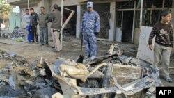 На месте одного из взрывов в Багдаде 22 декабря 2011г.