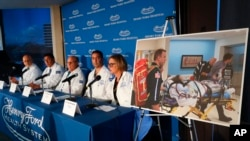 A photo of a patient being transported is displayed while medical staff at Henry Ford Hospital answer questions during a news conference in Detroit, Tuesday, Nov. 12, 2019.