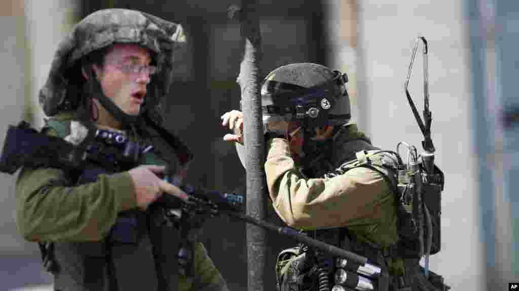 Sojojin Isra'ila A Lokacin Da Suke Artabu Da Sojojin Falasdinawa A kusa Da Birnin Hebron, Oktoba 14, 2015.