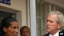 President Bush listens to an HIV positive mother explain how she has learned to keep her baby HIV free.