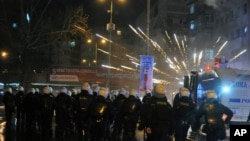 FILE - Riot police use water cannons to disperse protesters during an anti-government protest denouncing a corruption scandal that shook Prime Minister Recep Tayyip Erdogan's government, in Ankara, Turkey, March 1, 2014.