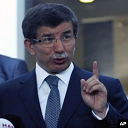 Turkish Foreign Minister Ahmet Davutoglu addresses the media in Ankara, August 10, 2011