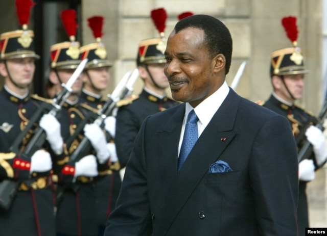 FILE - President of the Republic of Congo Denis Sassou N'Guesso arrives at the Elysee Palace in Paris, Sept. 20, 2002. N'guesso seeks to extend his already three decades in power in elections Sunday.